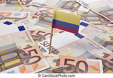 Flag of Colombia sticking in 50 Euro banknotes.(series)
