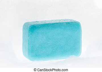 blue soap with foam on white background