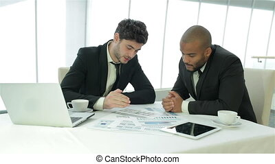 Two businessman discussing documents - Smiling businessman...