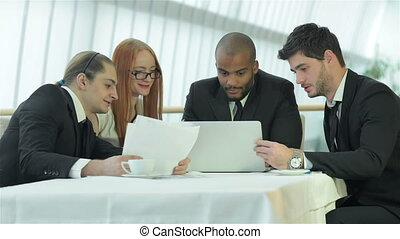 Business meeting with colleagues - Smiling businessman in a...