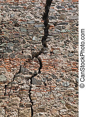 Cracked brick wall - Cracked red brick wall of a medieval...
