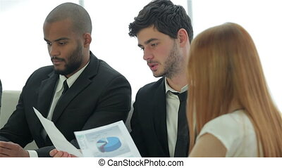 Businessmen sitting at table in office