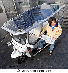 Solar powered tuc tuc - Driver of a solar powered tuc tuc...