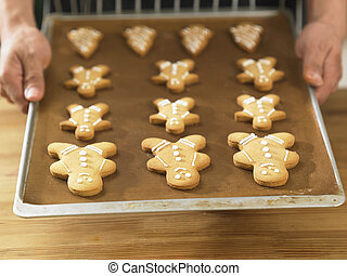 chistmas cookies - close up of the chef holding a tray of...