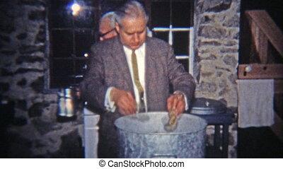 1965: Man showing off pot of oyster - Original vintage 8mm...