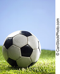 foot ball - close up of the football on the grass