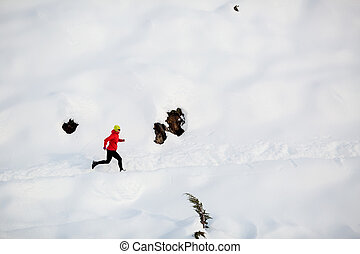 Woman running in winter mountains - Woman running on white...