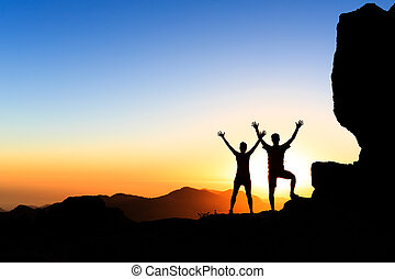 Couple hikers success concept in mountains - Couple hikers...