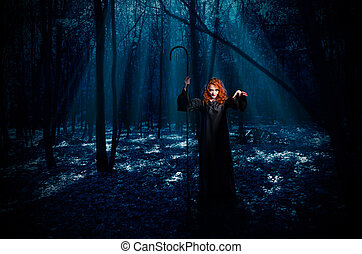 Witch in night forest - Young witch in night forest