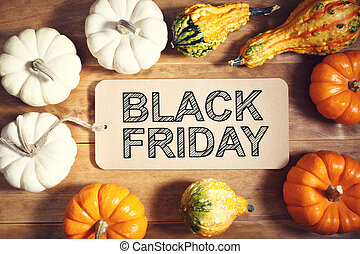 Black Friday message with colorful pumpkins and squashes