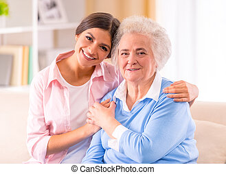 Old woman - Care of senior woman at home sitting on the...