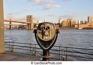 Binocular over looking the brooklyn bridge