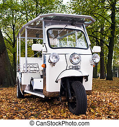 Solar powered tuc tuc - solar powered tuc tuc parked in a...