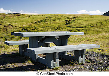 wooden picknick bench in green landscape in Iceland