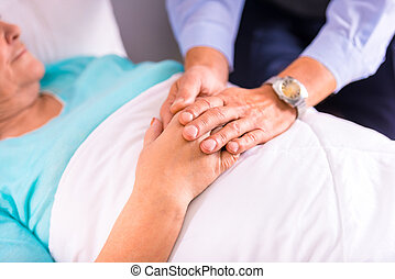 Old woman - Caring for a sick senior woman in hospital
