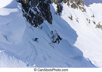 Skier in deep powder, extreme freeride - Skier in deep...