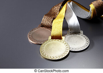 medals - gold,silver and bronze medals in a group