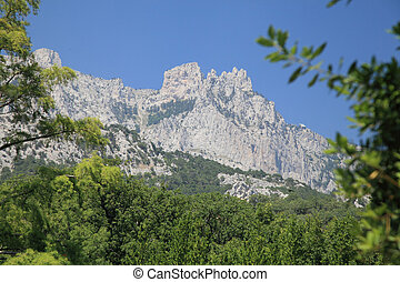 Mount Ai-Petri. - Mount Ai-Petri on a background of blue sky...