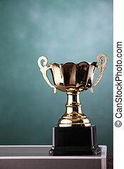 trophy in front of the blackboard
