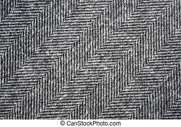 Herringbone tweed background with closeup on wool fabric...