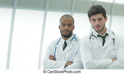 Portrait of two young doctors in medical gown