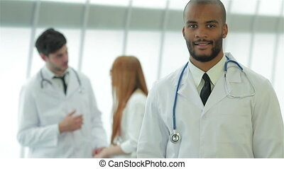 Portrait of a successful doctor showing two thumbs up -...