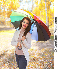 Portrait beautiful smiling woman with colorful umbrella in...
