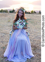 Attractive bride is holding a wedding bouquet - Attractive...