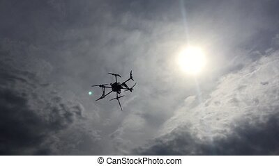 Modern drone is flying