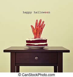 bloody hand in a cake and text happy halloween - the text...