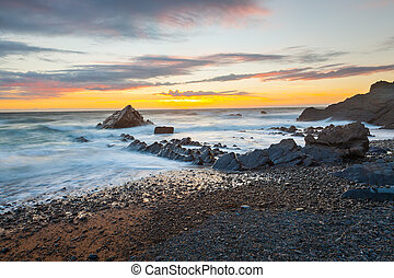 Sunset at Sandymouth Beach Cornwall - Dramtic sunset on the...