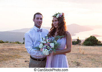 the bride and groom posing at sunset - the bride and groom...