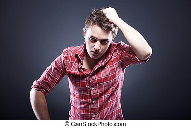Young man pulling his hair