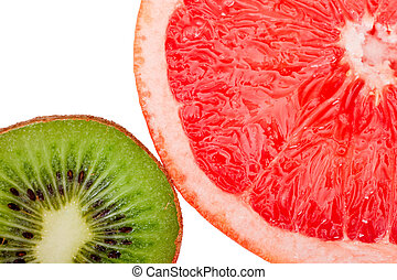 Macro shot of a red grapefruit and a kiwi isolated on white