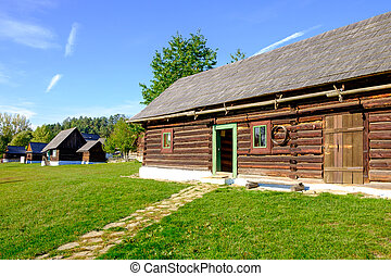 Old wooden barn and traditional village houses, Slovakia -...