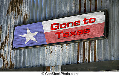 Gone to Texas. - Old gone to Texas sign on tin barn.