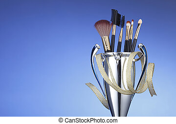 make up competition - brushes in the trophy on the blue...