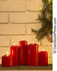 candle light under the christmas tree