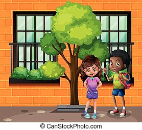 Boy and girl standing on the street