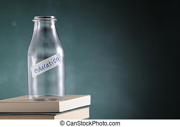 saving tool - empty glass jar labelled with text education