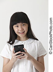 girl sending sms - chinese girl sending text message with...