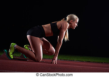 pixelated design of woman sprinter leaving starting blocks...