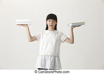 girl holding books - chinese girl balancing with books
