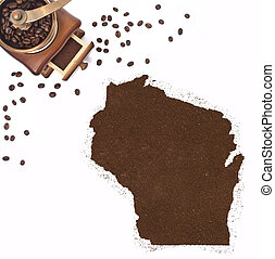 Coffee powder in the shape of Wisconsin and a coffee mill.(series)