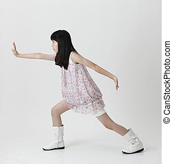girl praticing kung fu - chinese girl with fighting position