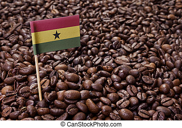 Flag of Ghana sticking in coffee beansseries - Flag of Ghana...