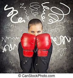 Businesslady in boxing gloves on abstract background
