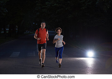 couple jogging at early morning - urban sports, healthy...