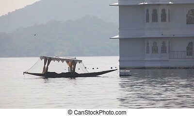 Boat an Udaipur lake - UDAIPUR, INDIA - NOVEMBER 24, 2012:...