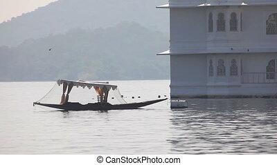 Boat an Udaipur lake - UDAIPUR, INDIA - NOVEMBER 24, 2012:...